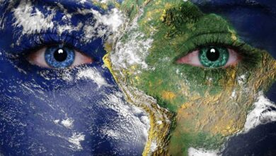 Earth painted on face. Elements of this image furnished by NASA. Gaia reminds us of our connection with the living Earth.