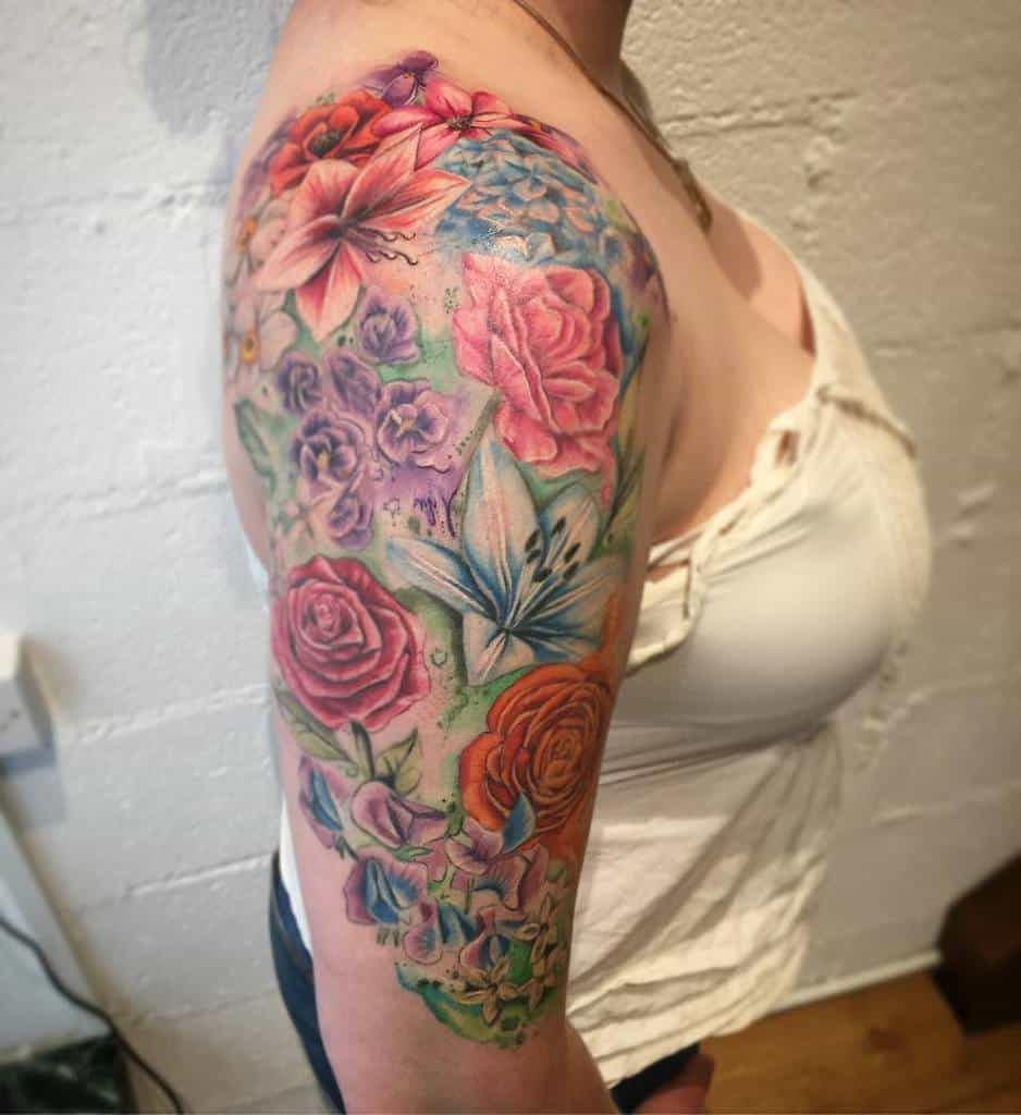 Tatouage de fleurs à l'aquarelle manchon sonia_jade