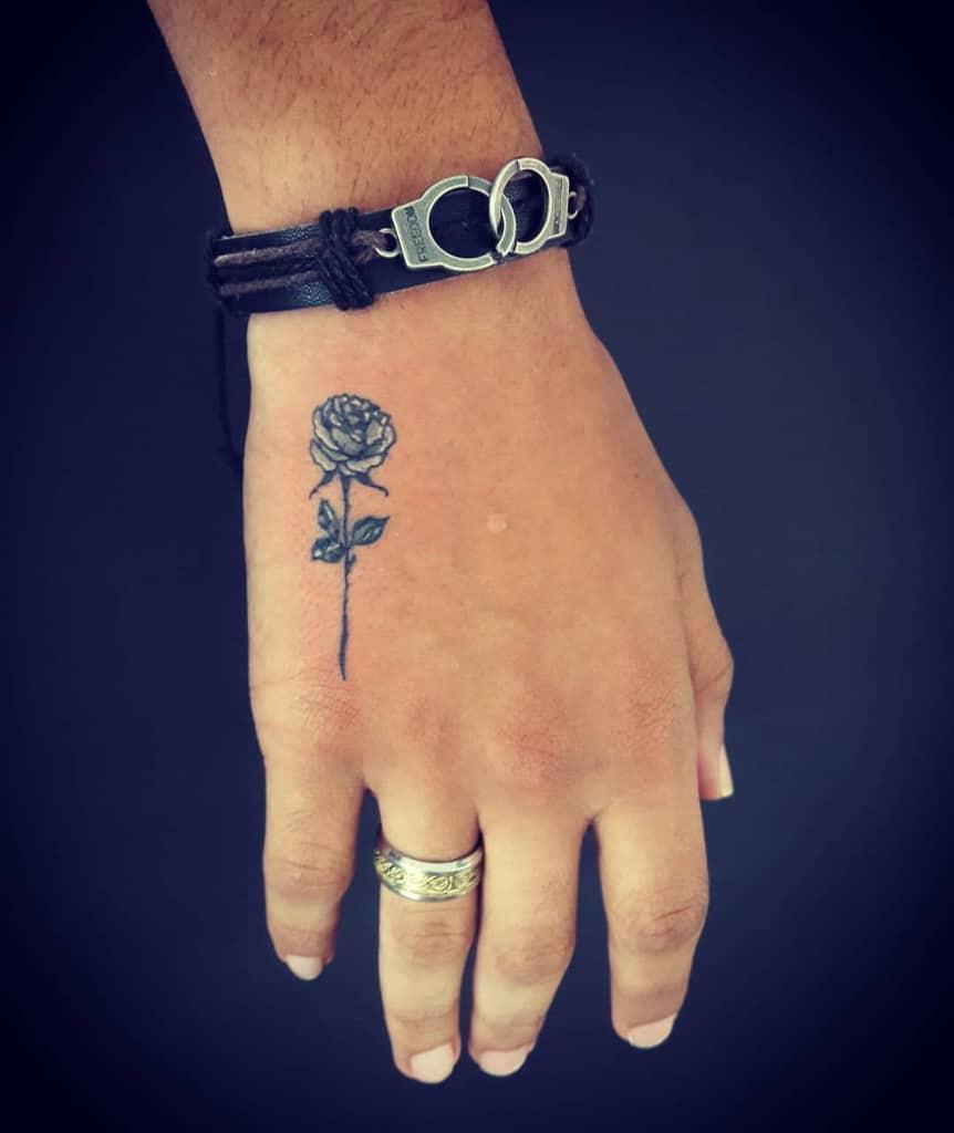 main minuscule rose tatouages magikbox_tattoos