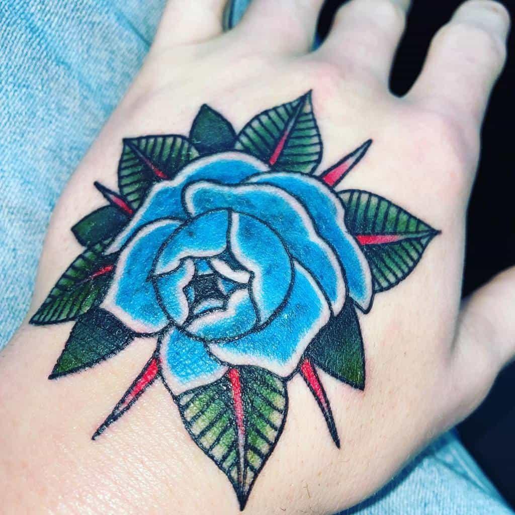main bleu rose tatouages haldermanzion