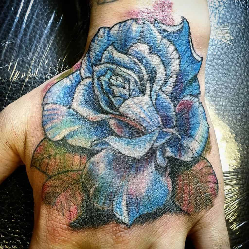 main bleu rose tatouages pjftattooart