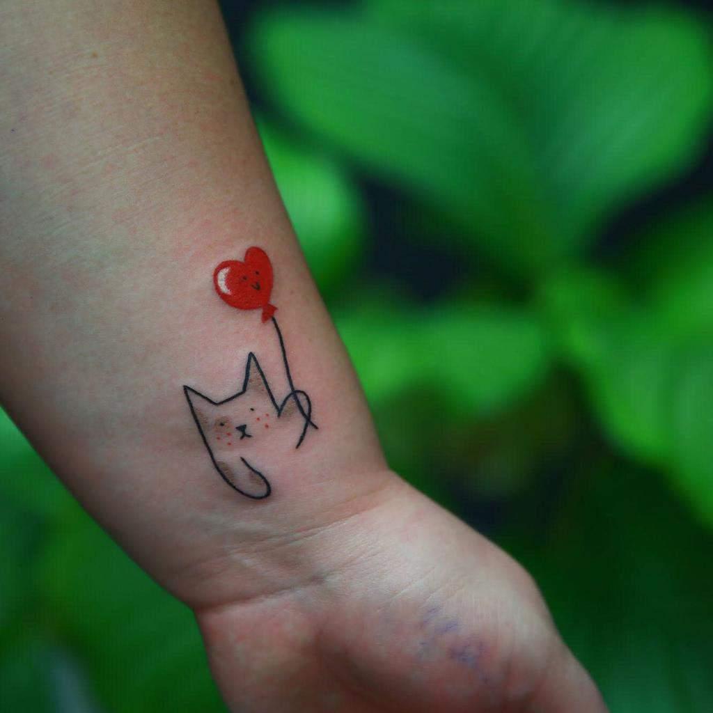 Tatouages de poignets de petits chats hiacyntaa