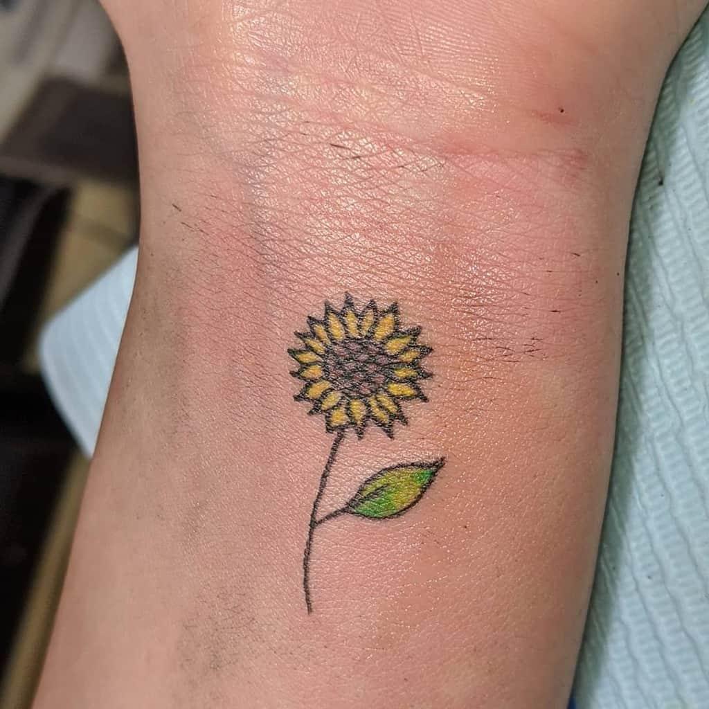 Tatouage de petit tournesol sur bras Antidotex