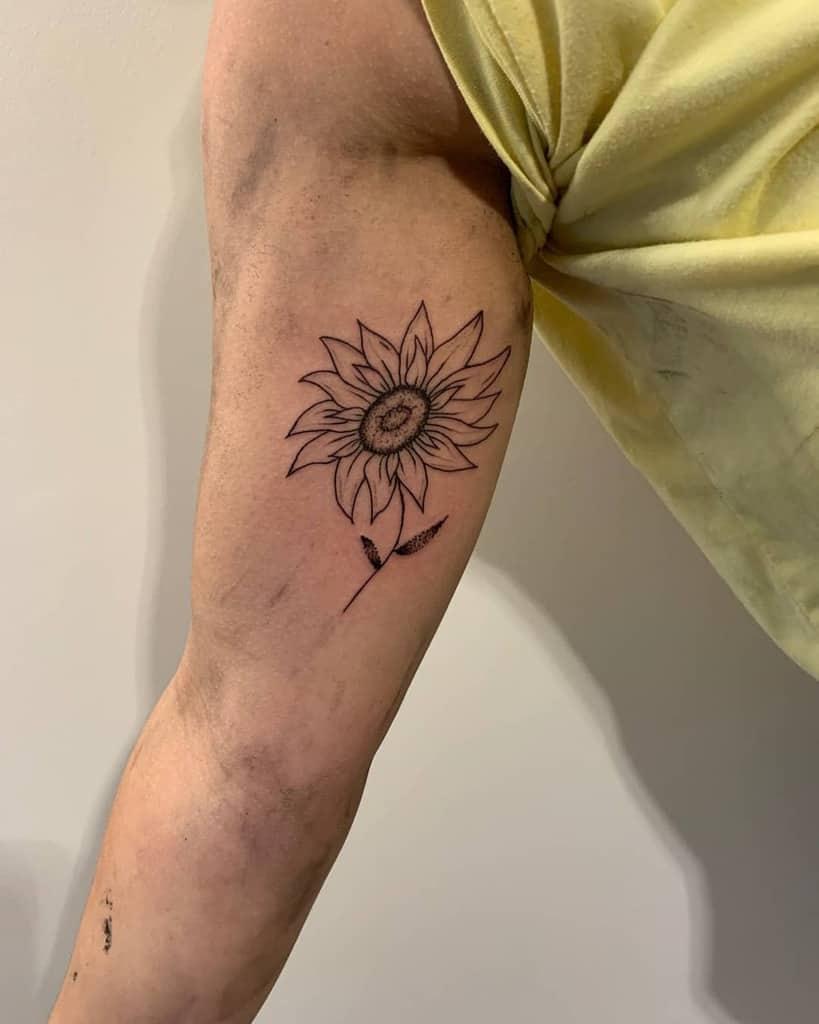 Petit Tatouage de Tournesol sur le bras Empusa.tattoo