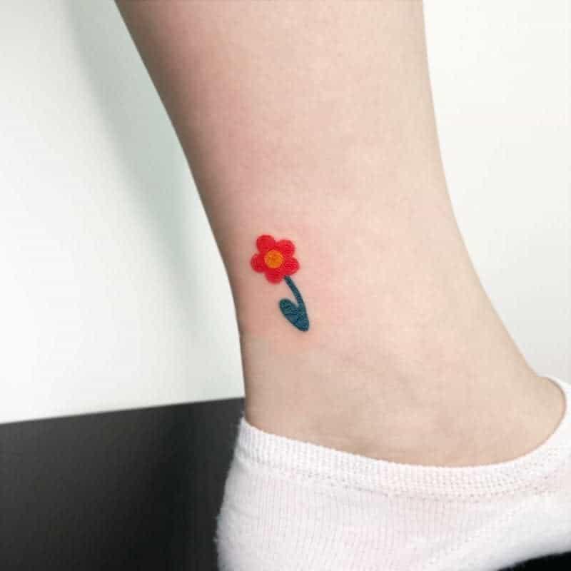 Tatouages de cheville à petites fleurs Tatouage de paon