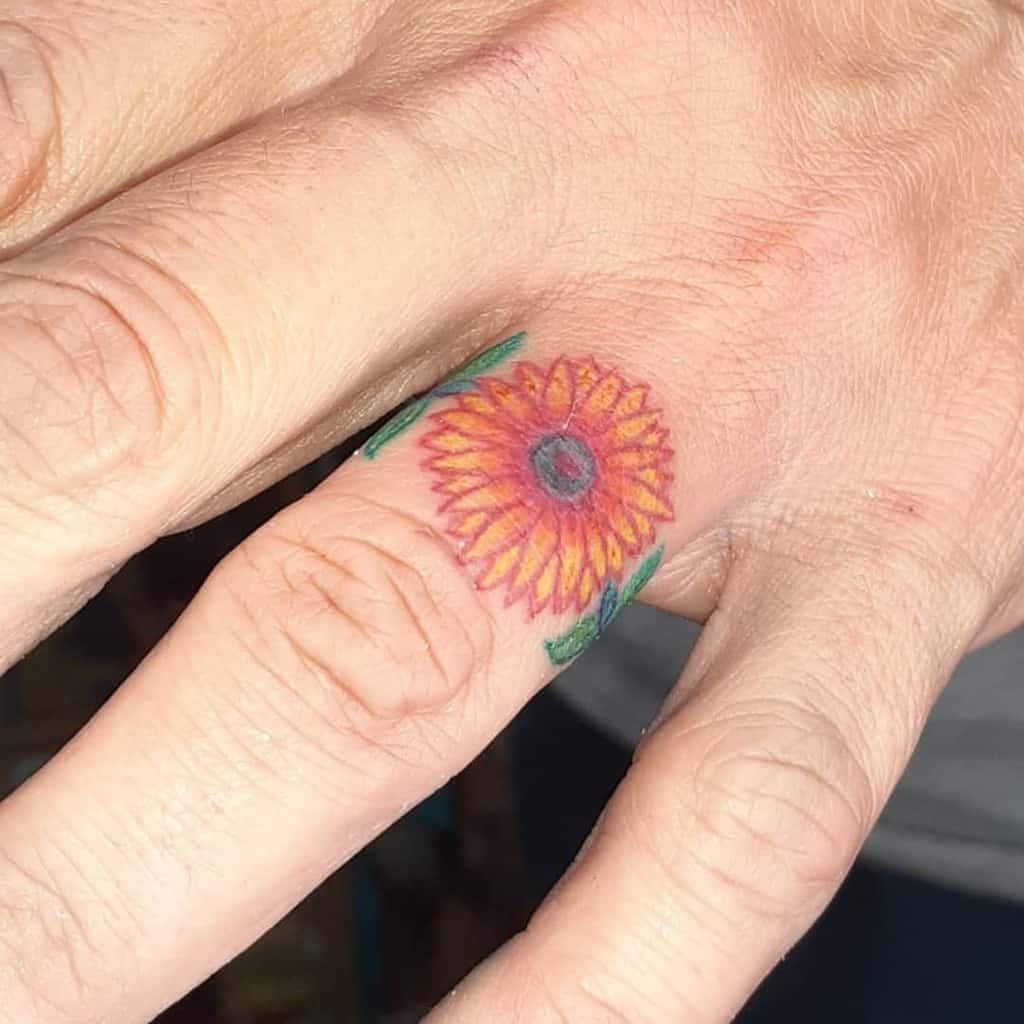 Tatouages des doigts de la main de la petite fleur Pattoosink