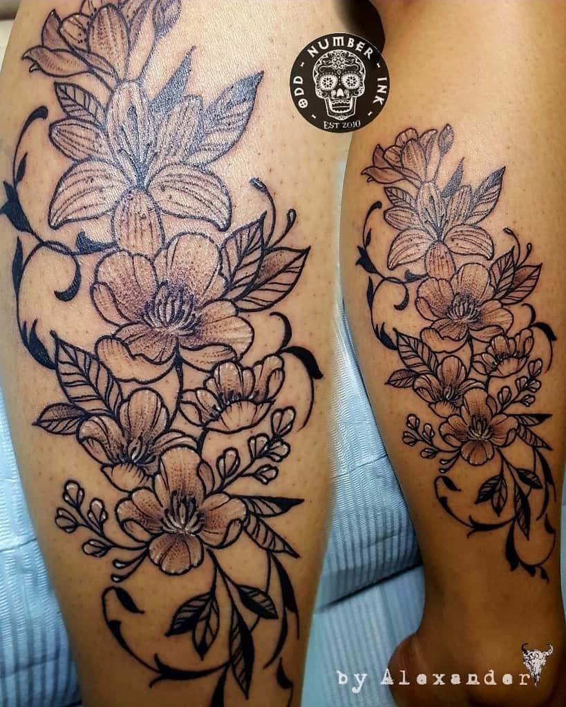 Tatouages de fleurs de jasmin sur les jambes Oddnumberinktattoostudio