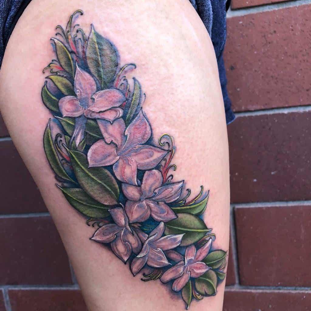 Tatouages de cuisses en fleurs de jasmin Tatouages d'ambre