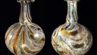 Roman marbled glass piriform unguentarium.