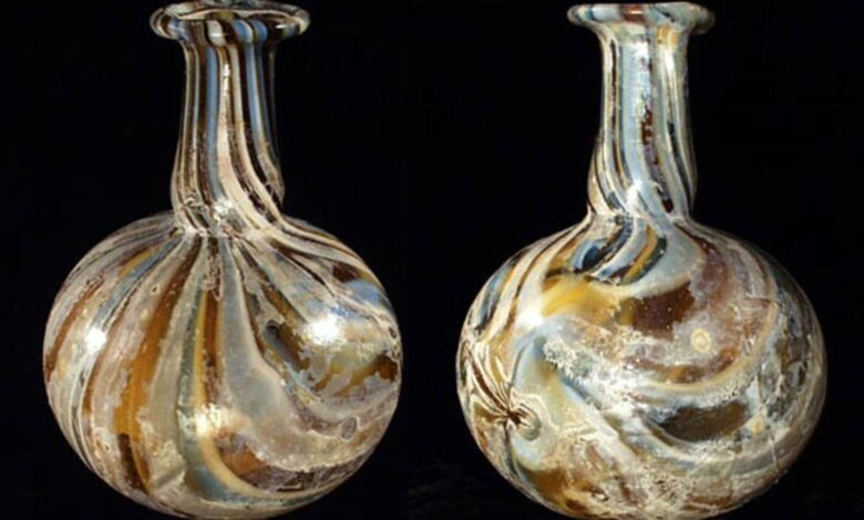Roman marbled glass piriform unguentarium.