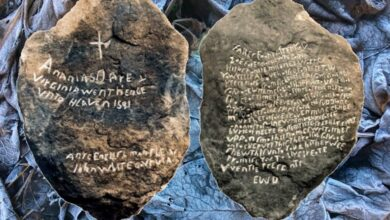 Front and back of the original Dare Stone