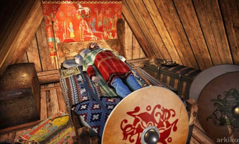 Reconstruction of the Myklebust Viking ship burial chamber c. year 870 AD, Norway, probably containing King Audbjorn of the Fjords. The king's head is resting on pillows filled with bird feathers.